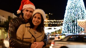 A-couple-gets-into-the-Christmas-spirit-in-the-German-Colony-district-of-the-northern-Israeli-city-of-Haifa.-Photo-by-Sapir-BronzbergFLASH90-1168x657